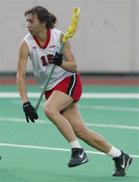 Jaimee Reynolds Wilson playing Lacrosse