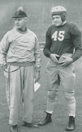 On the sidelines: Coach Carl Snavely (left) with team captain Walt Matuszak