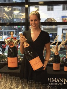Mizia on the job with a Methuselah (six-liter bottle) of Veuve Cliquot, one of Moet Hennessy's five Champagne brands. Photo provided.