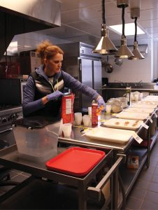 Susan Licker, doctoral candidate, readies trays of snack food for texture testing.
