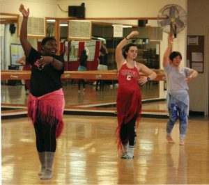 Students learn belly dancing.