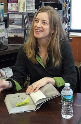 Abelson signs a copy of her book.
