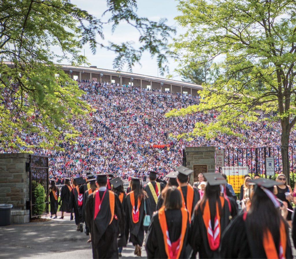 Graduates approach Schoellkopf, whose stadium is jam-packed with guests.