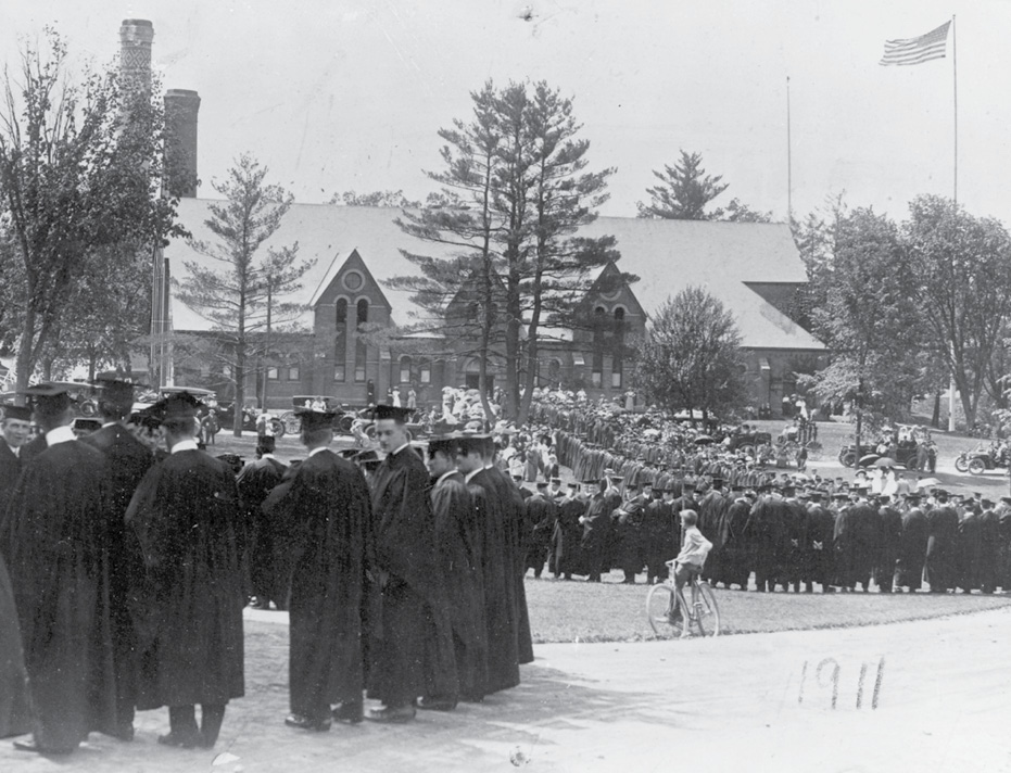 Graduates congregate near the University Armory.