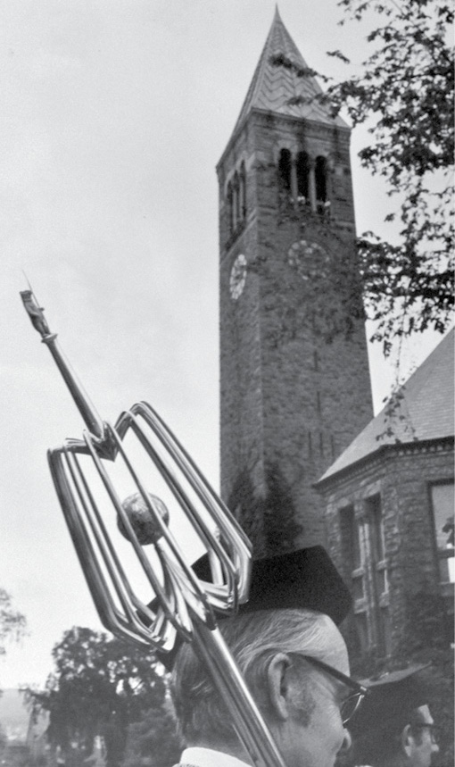 The symbolic university mace being carried past the clocktower.