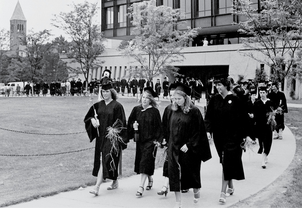 Students process past Uris Hall in the 1980s.