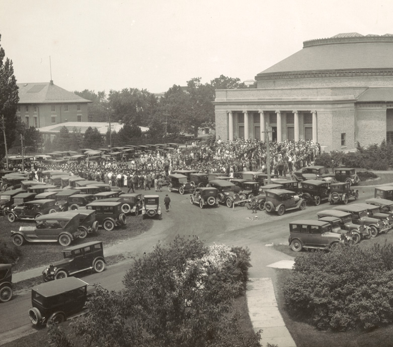 Bailey Hall with cars and graduates crammed in front in the 1920s
