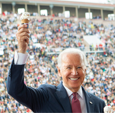 Joe Biden holds up his Dairy Bar ice cream flavor in front of convocation attendees