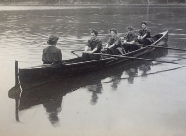 Four rowers and one coxswain row
