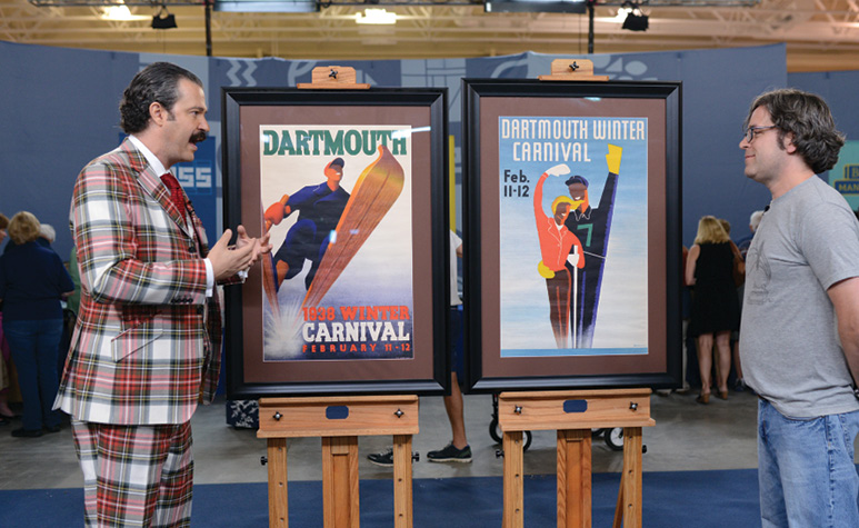 Lowry assessing vintage Dartmouth posters.