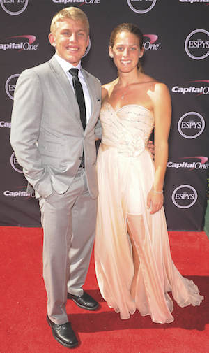 Dake and his wife pose on the red carpet at the ESPYS