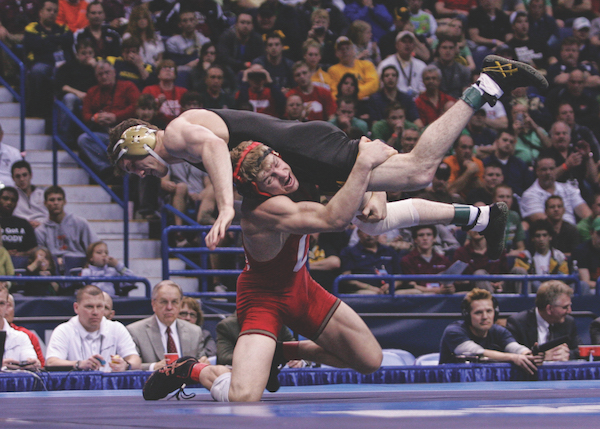 Dake hefts an opponent over his shoulder
